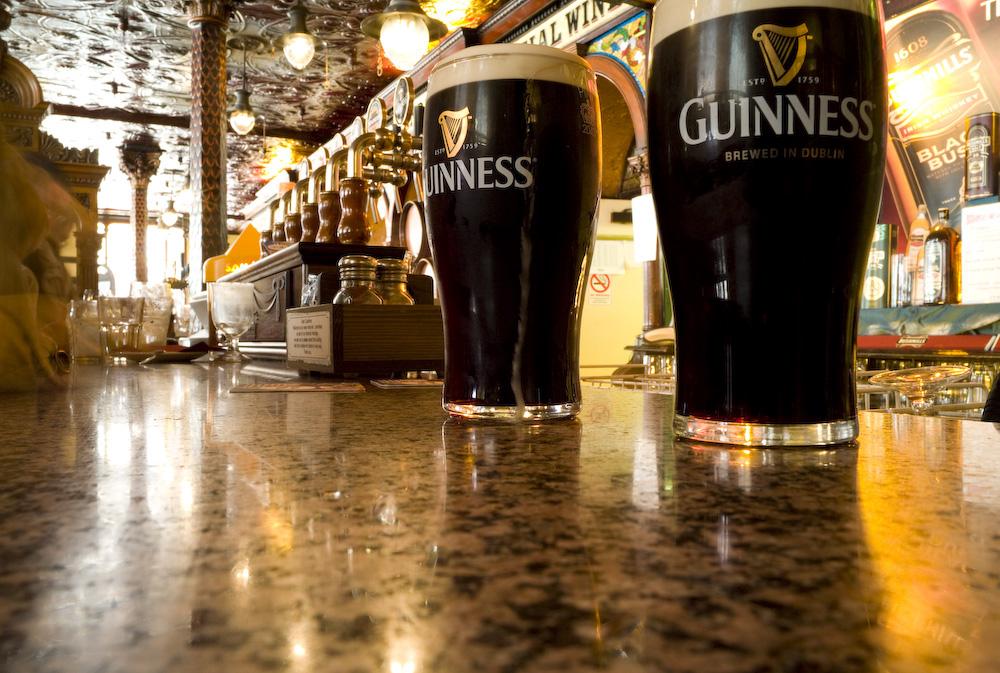 Guinnness pints on a bar Guinness storehouse