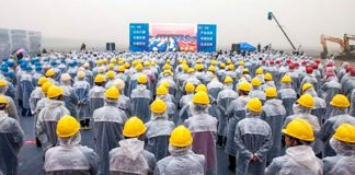 workers watch ceremony six flags haiyan china