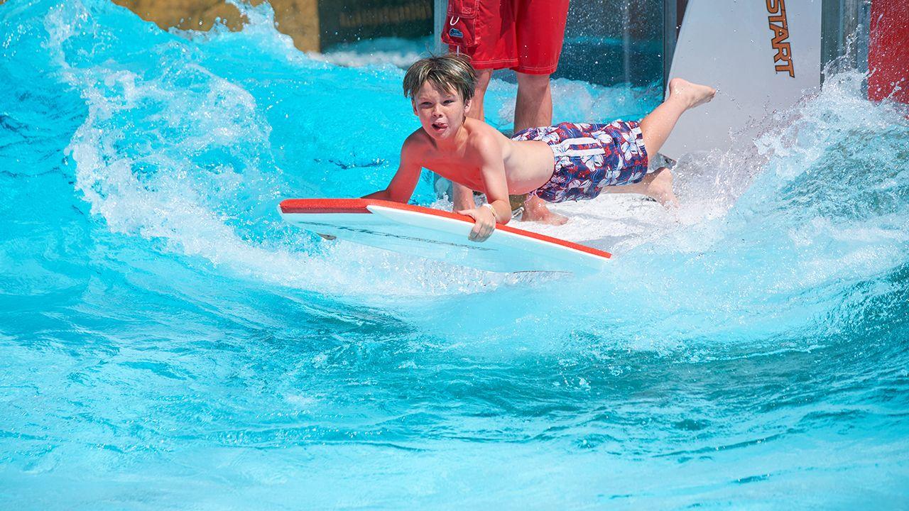 boy on surfboard adg waterpark