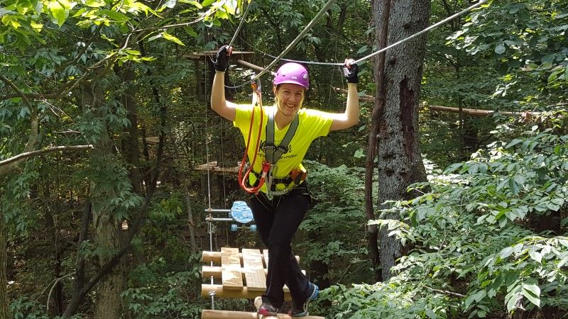 lady on zip wire at edge adventure parks