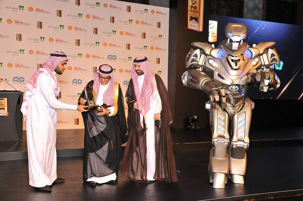 Titan the Robot Accepts 'Best Marketing Campaign' Award on Behalf of Toyota