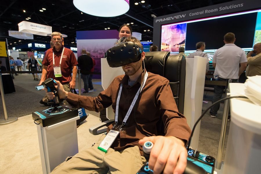 man tries vr goggles at infocomm
