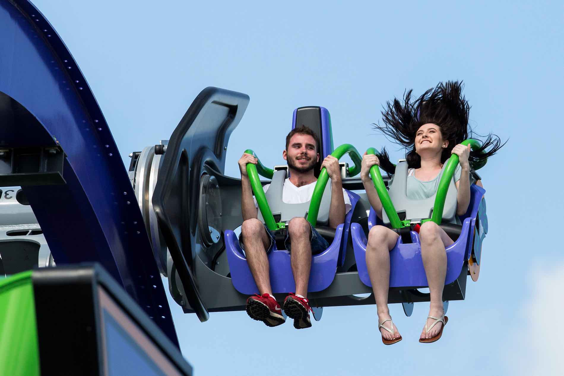 couple on roller coaster at six flags over texas