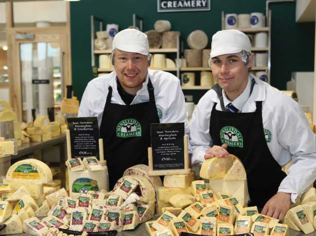 Cheese Shop with staff press Wensleydale Creamery