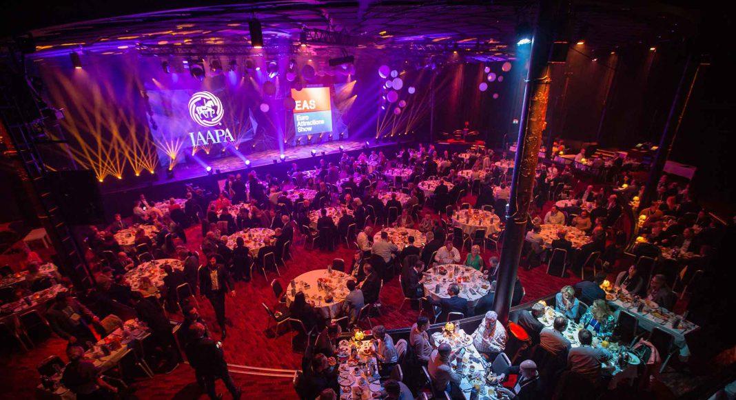 IAAPA EAS showroom presentation tables chairs people purple blue lighting final tickets