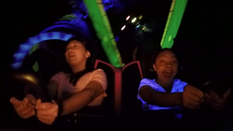 riders on a rollercoaster location-based entertainment jpeg