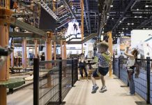 child tries Sky Tykes ropes course with sky rail zip line from innovative leisure