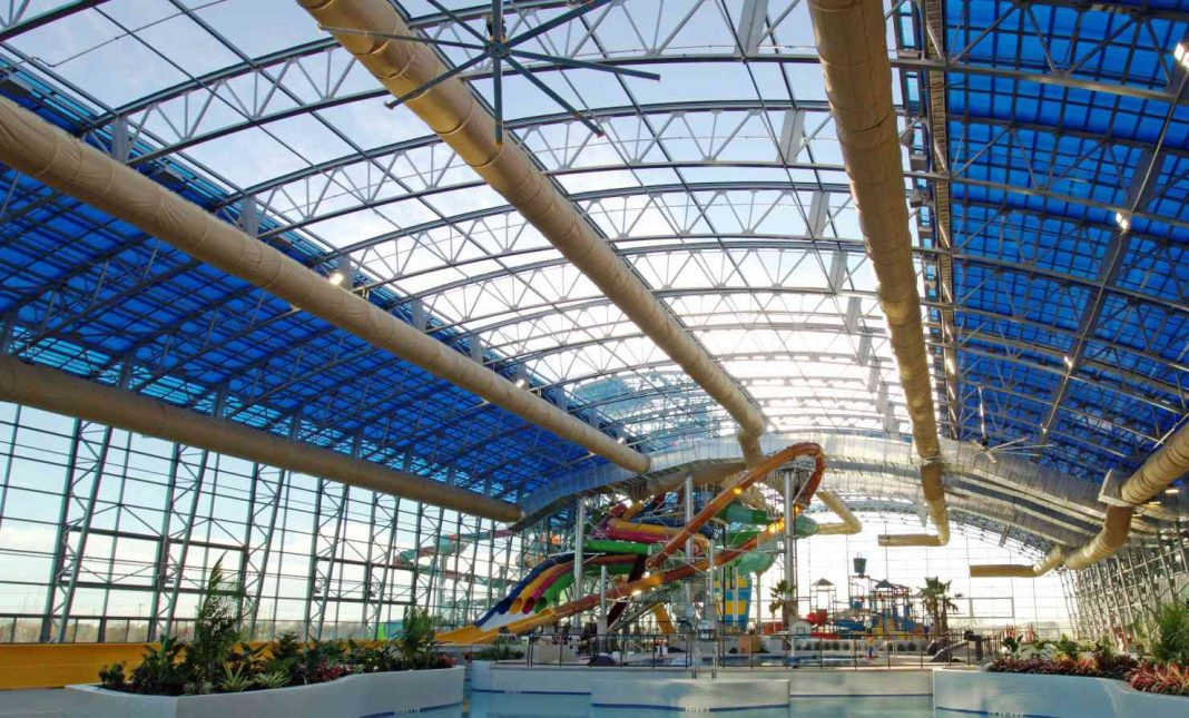 retractable roof at Epic Waters indoor waterpark by OpenAire
