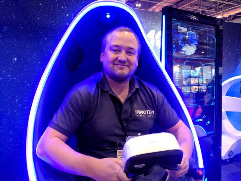 mark whittaker riding immotion group's virtual reality gaming vehicle