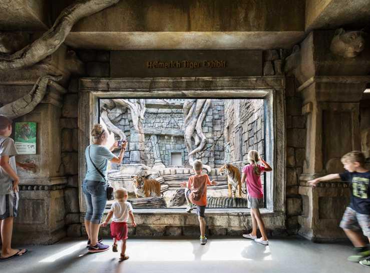 mum and kids view tigers at PGAV-designed Lost Kingdom exhibit Tulsa Zoo