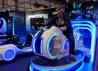 man on vr ride immotion group eag virtual reality a