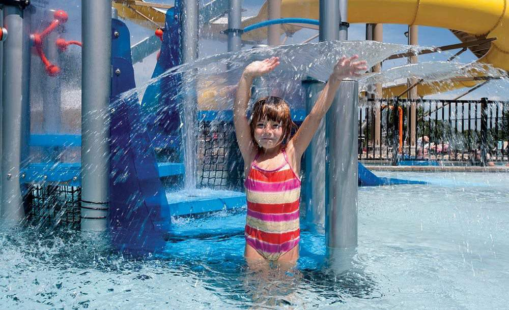 girl under water spout waterplay solutions sean hare