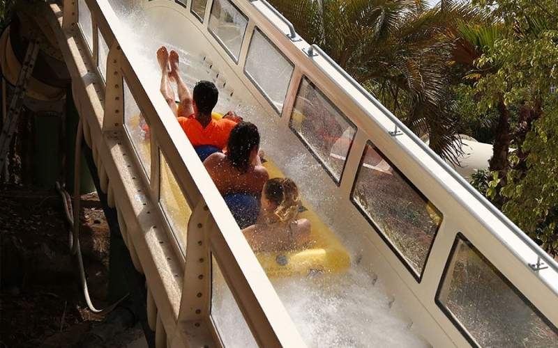 people riding proslide rocketblast water coaster