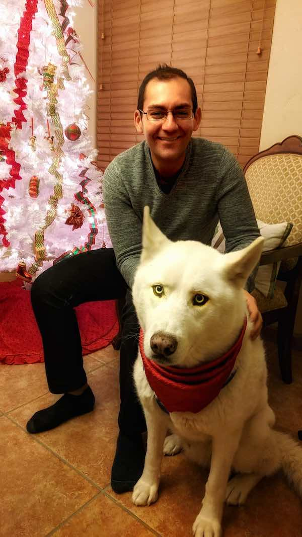 Philip Hernandez with white dog gantom a