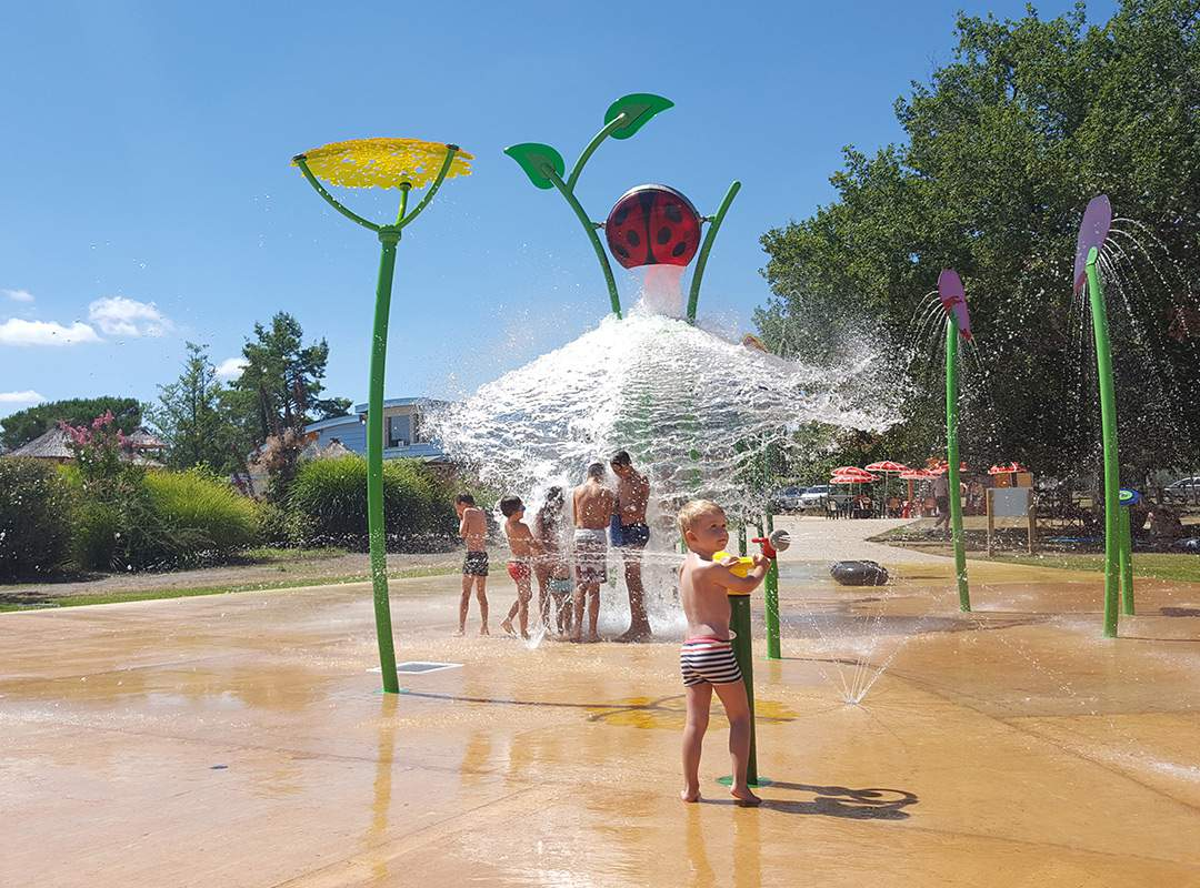 boy plays with waterplay's ladybird soaker installed by KASO