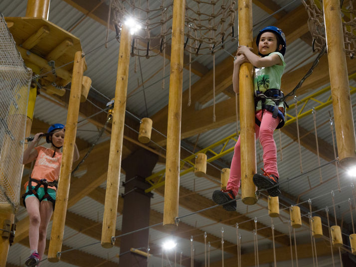 children on kanopeo aerial ropes course speedrunner belay system