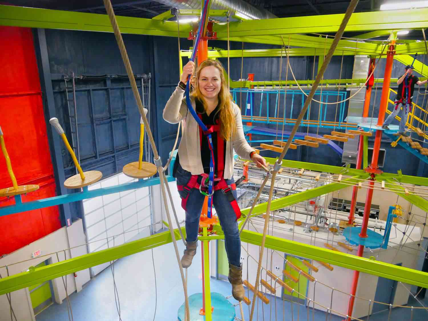 ropes courses woman tries out single redundant slingline