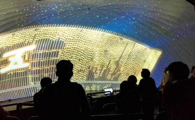 vistors to hunan museum view multimedia exhibit, divination of the five planets