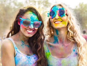 two girls in sunglasses at colour run event
