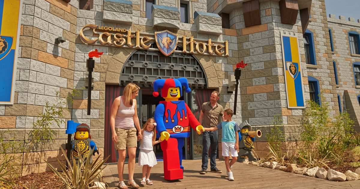 family and jester outside legoland castle hotel themed by scruffy dog