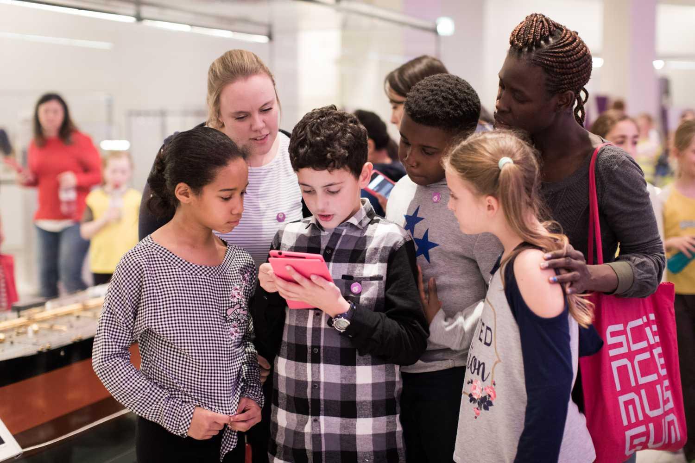 kids at science museum using aardman treasure hunters mobile tour app
