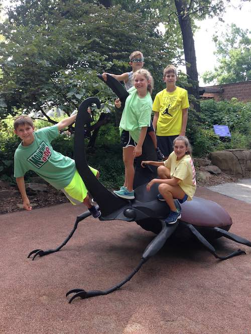 Bryan Meyer kids on scarab beetle sculpture a
