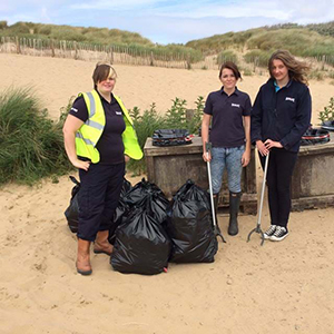 litter pickers beach rubbish group