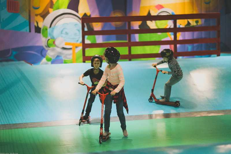 kids on scooters indoor play