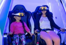 mother and child experience Immotion VR ride at Legoland Discovery Center Boston