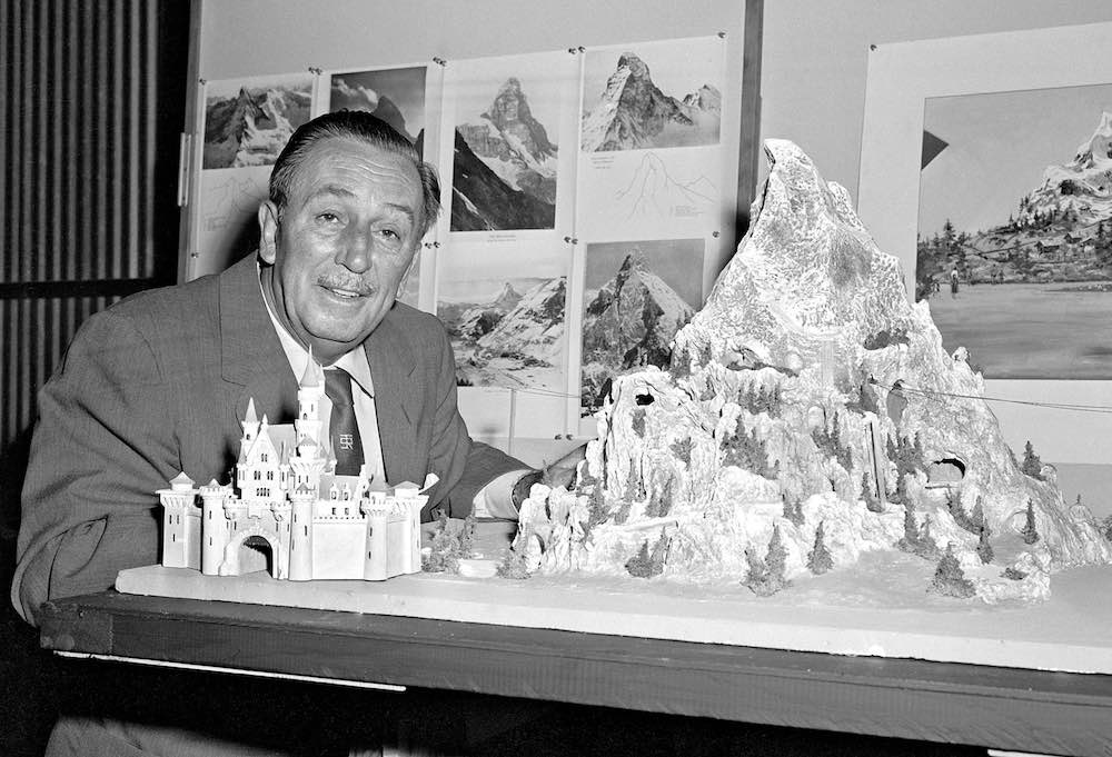 Walt Disney reviews a model for the Matterhorn Bobsleds which opened in 1959 at a height of 147 feet.