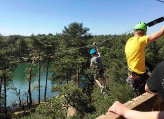 boy rides zilvermeer zipline with kanopeo saferoller belay system