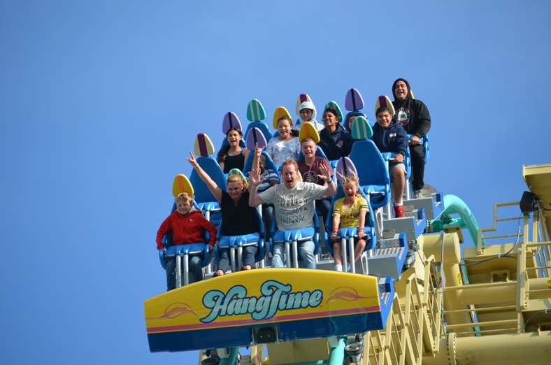 riders on hangtime surf-themed coaster at knotts berry farm