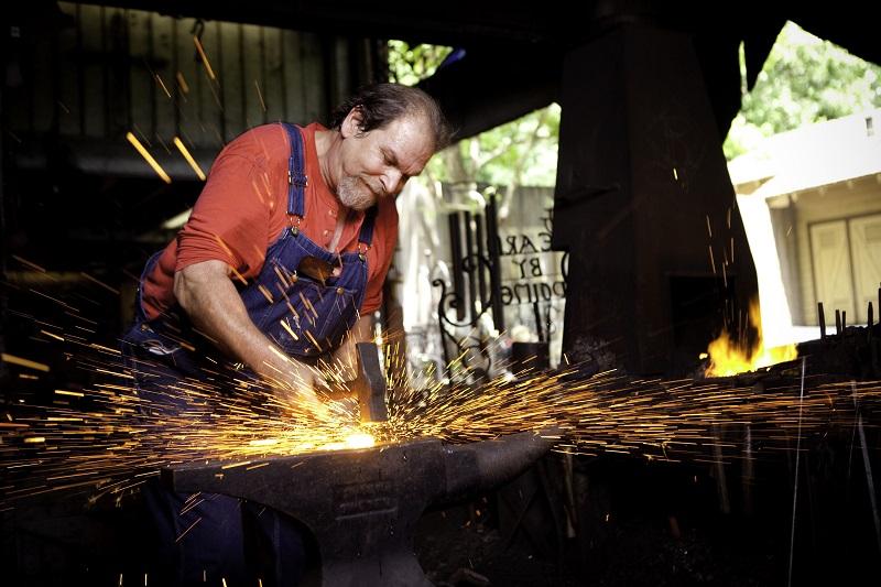 dollywood blacksmith sparks forging man