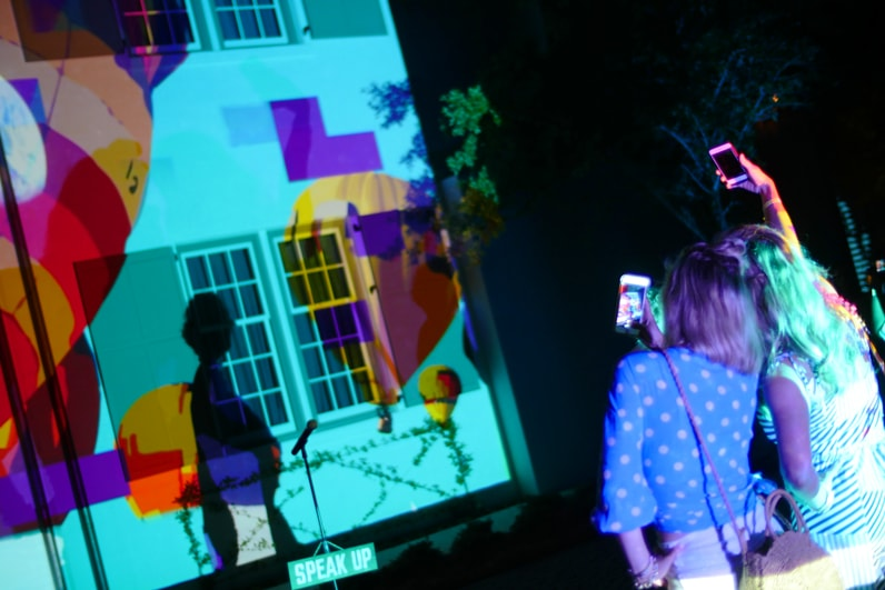 viewers take selfies at digital graffiti art festival