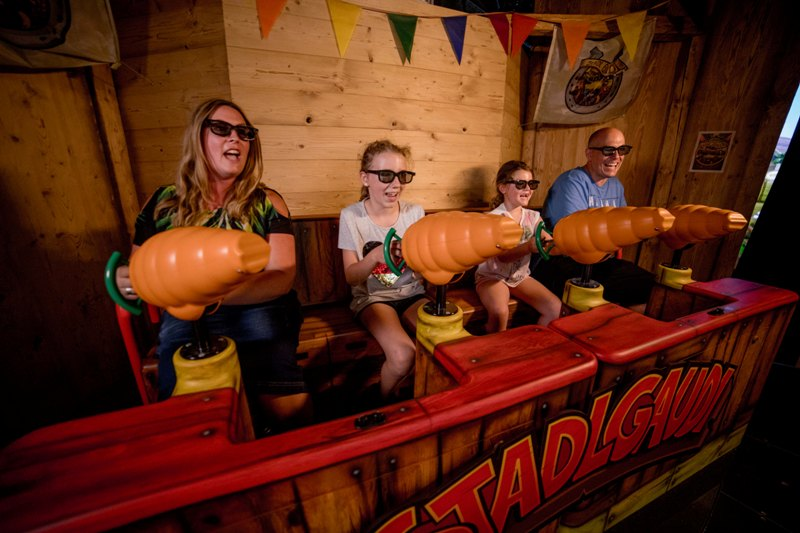 players fire carrot cannons in stadlgaudi 4D dark ride