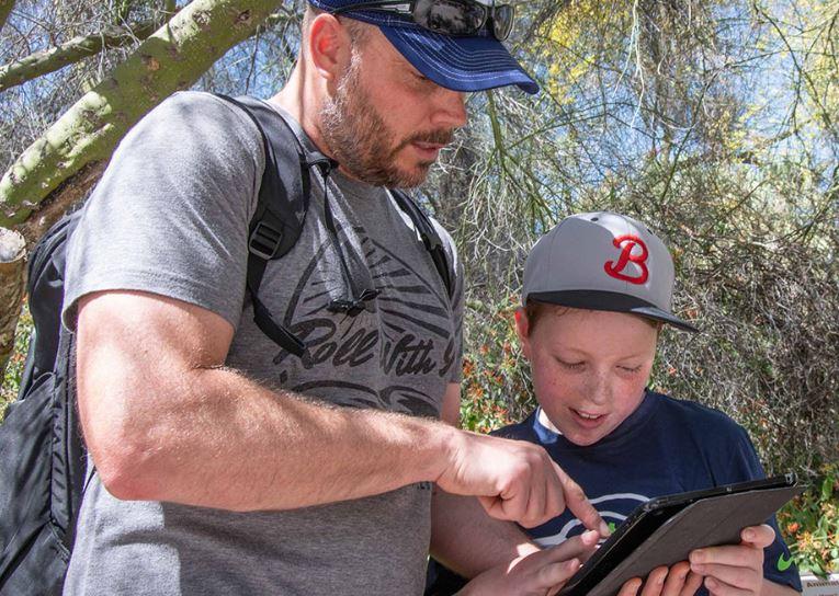 father and son use guru mobile app at Rancho Santa Ana Botanic Garden