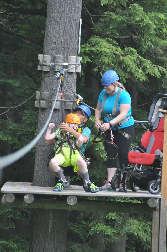 disabled child on zipline at treetop eco adventure park