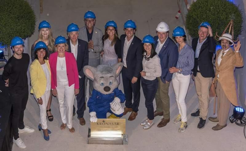 Mack family in hard hats at construction site of kronasar hotel