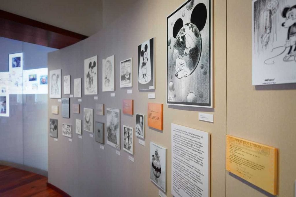 Wall display of Disney artwork