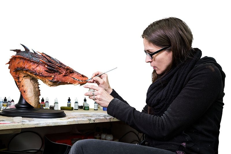 sculpting a model dragon at weta workshop in NZ