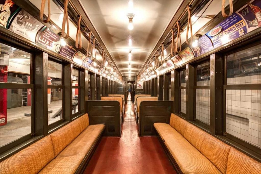 Photo of the interior of a train carriage in the New York Transit Museum