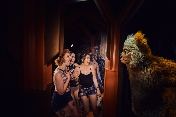 Guests getting scared at The Shining haunted house at Halloween Horror Nights