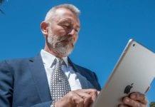 man uses Balboa park tour app by guru