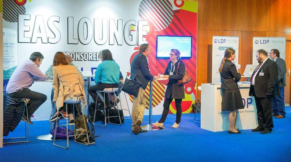 people in business lounge at euro attractions show