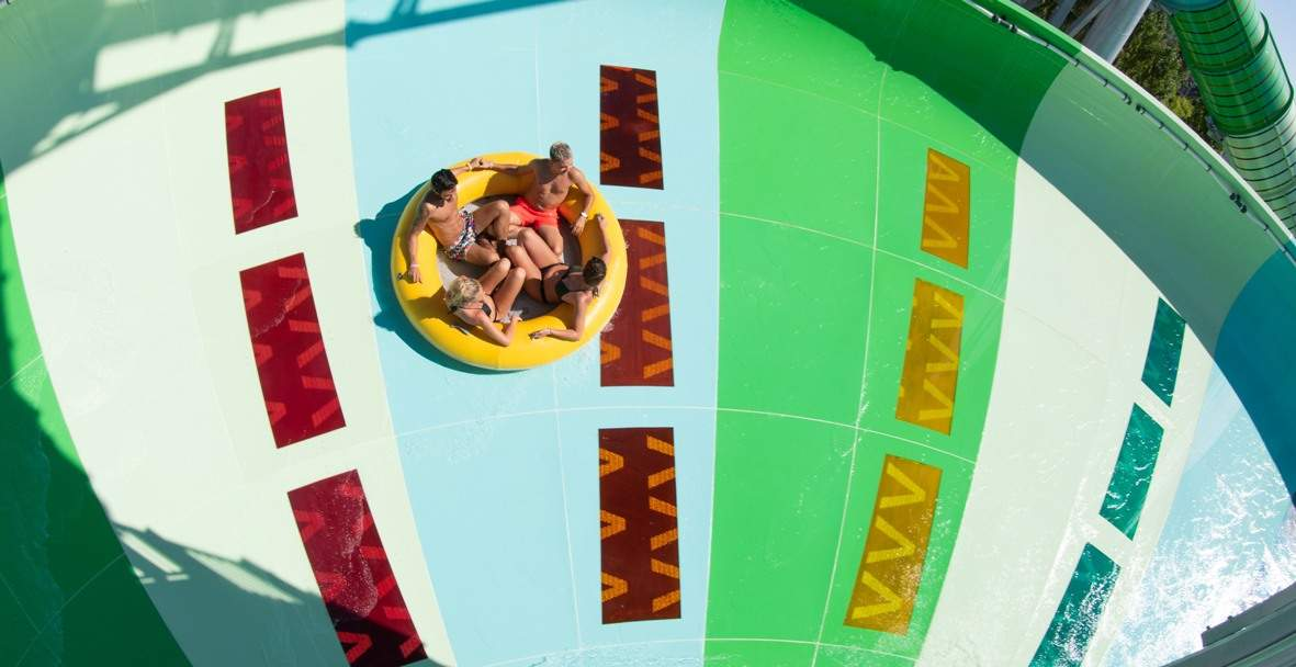 Guests on raft Polin Storm Racer waterslide at aqualand frejus