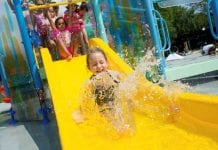 toddler on playnuk waterslide by vortex
