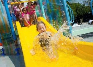 toddler on playnuk waterslide by vortex