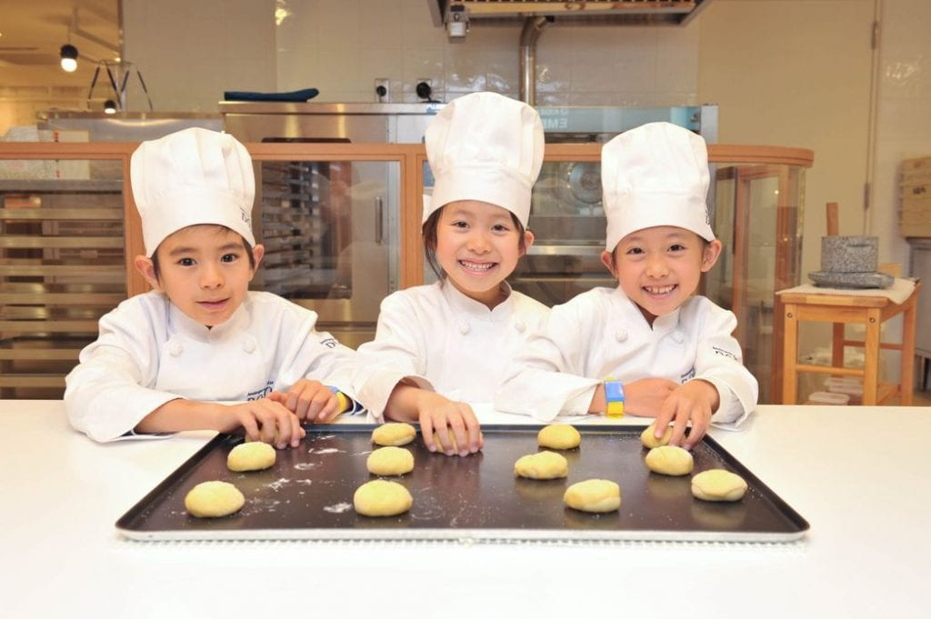 KidZania Bakery, three young bakers