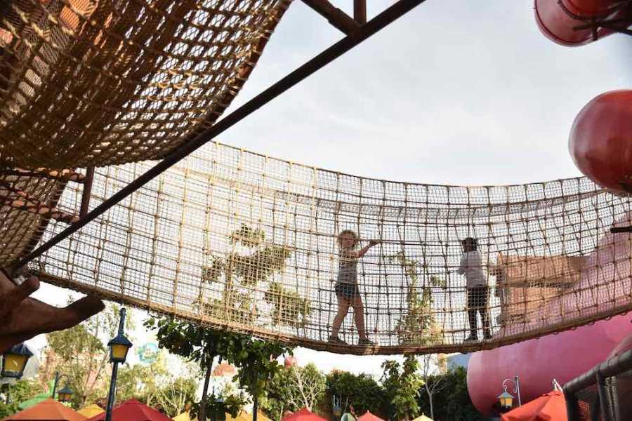 children play on rope bridge adventurers whitewater survey