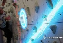 girl climbing valo motion augmented climbing wall